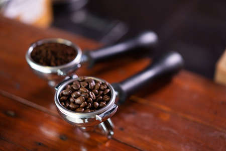 showing two fresh coffee beans on a table