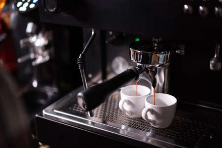 Close up making coffee progress.