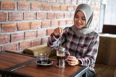 asian female stir coffee background. Stok Fotoğraf