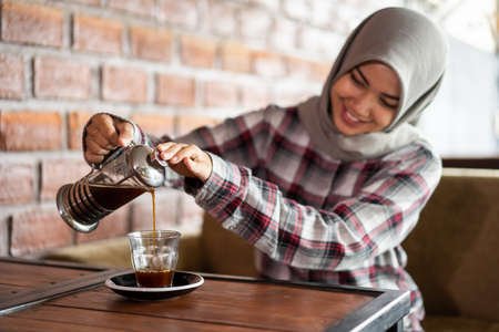 asian female pouring coffee background. Stok Fotoğraf