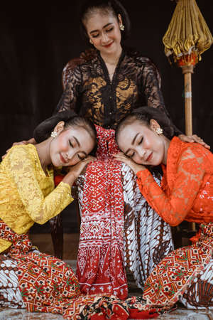 portrait of a woman wear a traditional javanese costume