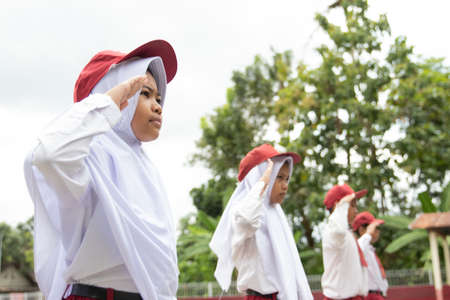 Flag honor is performed by the Indonesian elementary students