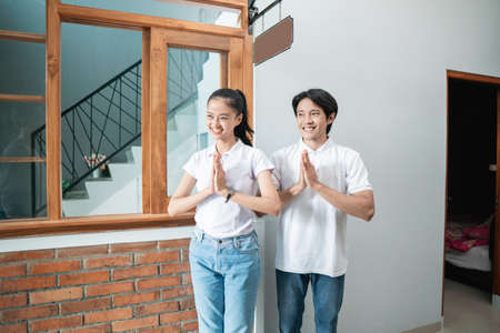 attractive homestay owner welcoming guest at their hotel