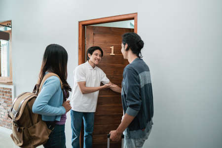 guesthouse staff welcoming couple in boutique hotel