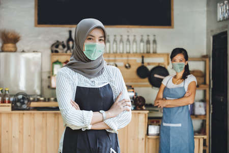Successful muslim asian small business owner