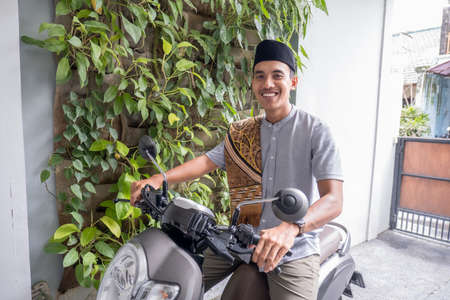 muslim male going to the mosque by riding motorbike