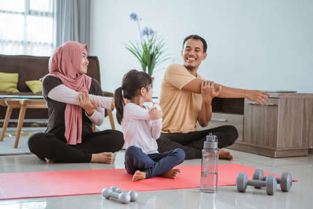 beautiful family exercising at home together