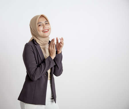 woman entrepreneur wearing hijab smiling applause, office work concept isolated white background Stock Photo