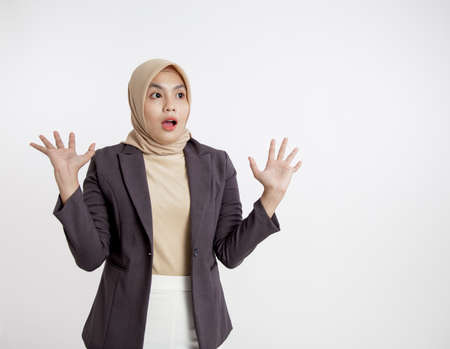 women wearing suits hijab surprised looking at her left side, formal work concept isolated white background