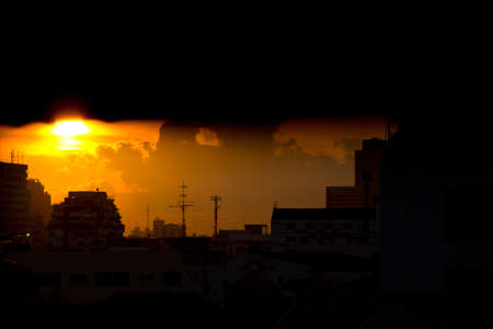 dark city: The morning sun