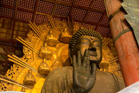 human being: Daibutsu at Todaiji Temple. His open hand alone is as tall as a human being. Stock Photo