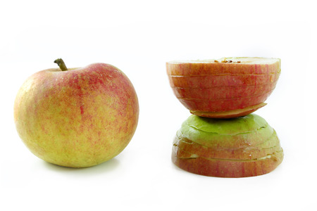 needless: apple before: round in natural beauty, after: disfigured slim by plastic surgery, metaphor for risks in cosmetic surgey or liposuction because of beauty diktat, isolated on white background Stock Photo