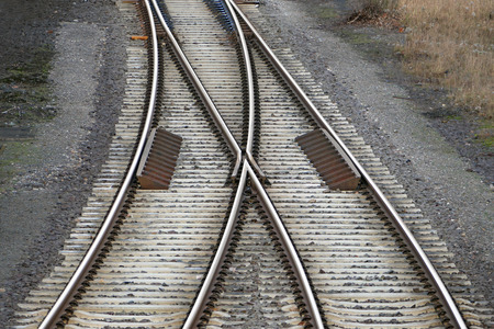 railway track: railroad tracks with railroad switch, two paths lead together