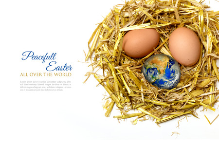 peacefull: eggs in a nest of golden straw, isolated on white background, sample text in the copy space peacefull easter all over the world