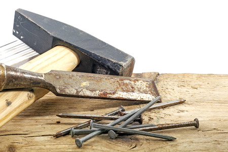 woodworker: old woodworker tools and nails on rustic wood, copy space in the white background