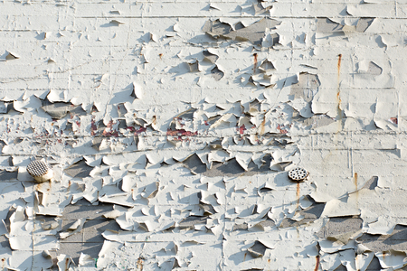 deficiency: Construction deficiency, facade with exfoliated white color, background texture