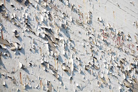flaking: house wall with flaking white paint, background texture Stock Photo