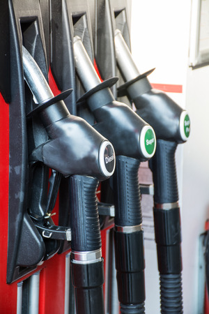 gas pump: gas pump nozzles in a service station, upright Stock Photo