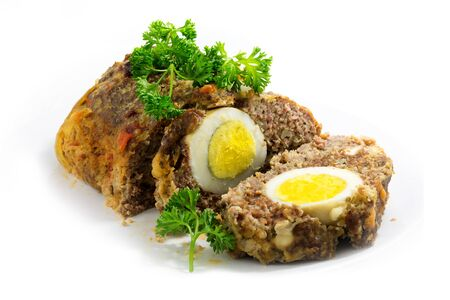 meatloaf: meatloaf with boiled eggs inside for Easter, isolated on white background Stock Photo