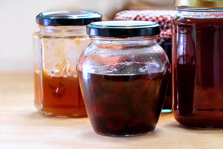 teatime: partly used jars with various homemade fruit jam, ready for breakfast or teatime