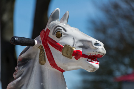 Head of an old carousel horse or a coin operated rocking horse automat photo