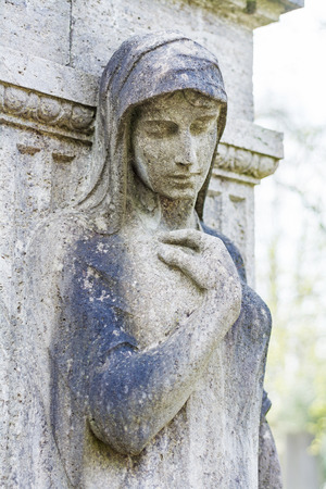 femal: femal statue as a grave stone on an old cemetery Stock Photo