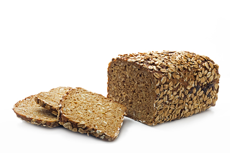 rustic bread loaf and slices with whole grain and seeds isolated on a white background Stock Photo