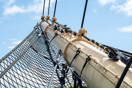 bowsprit: bowsprit and safety net of a historic Tall Ship against the blue sky