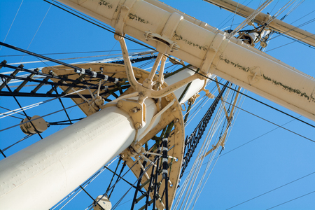 masts: view into the masts and rigging of a historic tall ship against the blue sky
