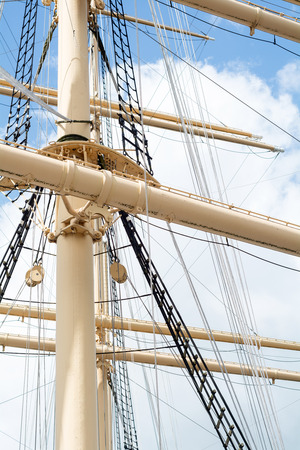 masts: view into the masts and rigging of a historic Tall Ship, vertical Stock Photo