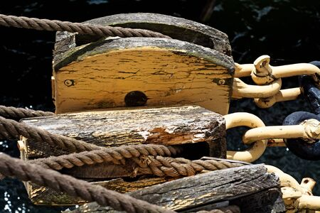 pulley: ropes and old weathered pulley on a historic sailing ship