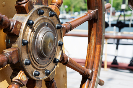 narrow depth of field: steering wheel made of wood on a large historical Tall Ship, narrow depth of field