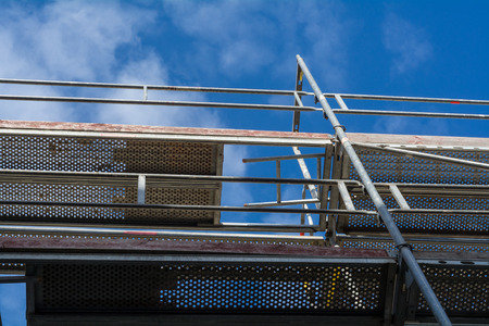 gripping bars: Scaffolding elements with a view in the blue sky