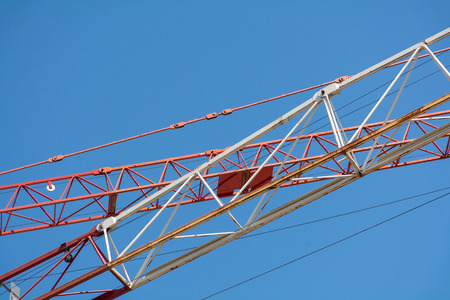 figuring: two crane arms cross one another diagonally against the blue sky, copy space Stock Photo