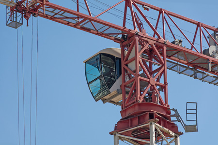 Drivers cab of a crane high in the blue sky, copy space