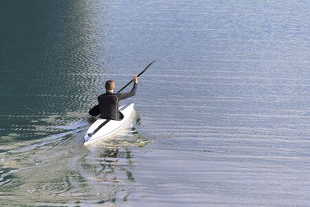 paddler: paddler in a kayak alone on the blue water, copy space