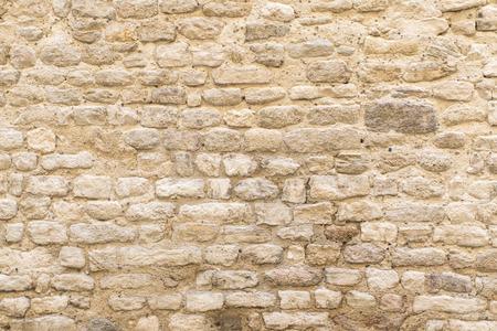 textuur, muur van bleke natuursteen in het oude centrum van Apt, Zuid-Frankrijk