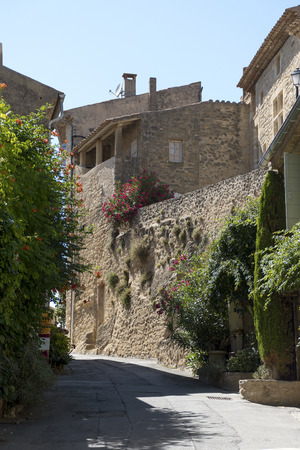 luberon: Narrow street with typical houses and flowers in the old village of Ansouis, Provence, France, region Luberon