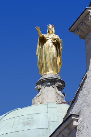 apt: golden statue of Saint Anne on the Dome of the Cathedral of Sainte Anne against the blue sky in Apt, Provence, France Stock Photo