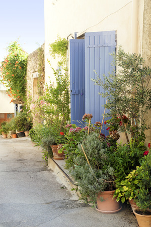 luberon: Pot garden in a narrow street, typical in southern Europe, Ansouis, Provence, France, Luberon region Stock Photo