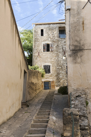 luberon: narrow street with staircase in an old village in southern Europe, Cucuron, Provence, France, Luberon region