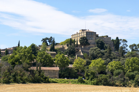 luberon: Historic castle on the hill, the Chateau and the village of Ansouis is a tourist attraction in the southern region of Provence, region Luberon, France. Editorial