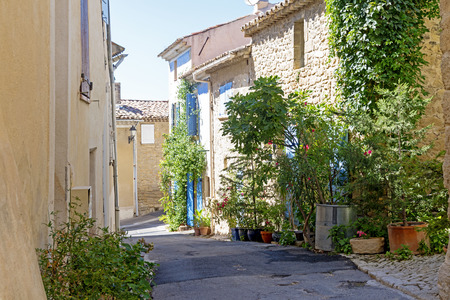 luberon: Sunny street with typical houses and plants in the old village of Ansouis, Provence, France, region Luberon