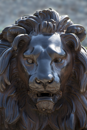 beck: face of a lion sculpture made of bronze, near the Holsten Gate in Lübeck, Germany Stock Photo