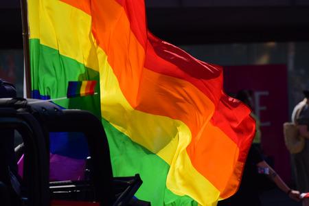 wedding parade: Rainbow Flag on the Pride Parade, CSD (Christopher Street Day), dark background Stock Photo