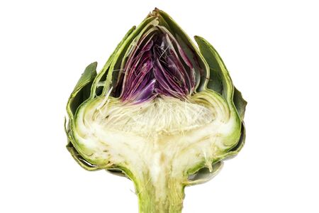choke: half artichoke, showing the heart and choke under the green and red leaves,  isolated on a white background