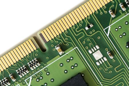 dimm: part of a computer ram memory barrette over white, macro shot with very shallow depth of field