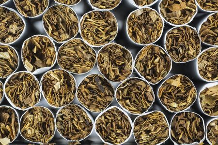vices: Cigarette stack as a background texture, close up from the front Stock Photo