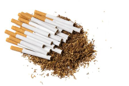 vices: many filter cigarettes on a heap of loose tobacco, view from above, isolated on a white background