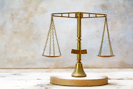 vintage balance scales made of brass, concept for justice